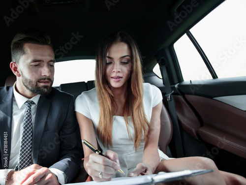 Fridge magnet man and woman discussing work documents in taxi