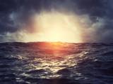 Sunset on stormy sea - 218186053