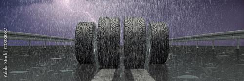 Leinwanddruck Bild Reifen auf nasser Fahrbahn im Regen