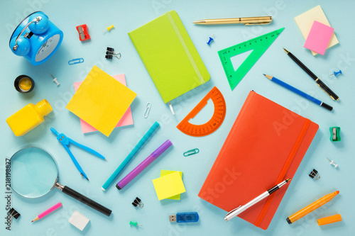 Foto Murales notebook and school accessories at abstract background