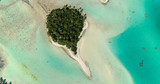 small islands (motu) in the middle of a lagoon in aerial view, French Polynesia - 218210687