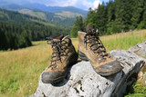 hikers boots on stone - 218229691