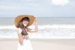 Beautiful girl enjoy and happy on the beach, Hua Hin, Thailand