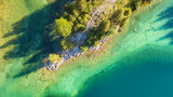 Aerial view on the lake and forest. Natural landscape from drone. Aerial landscape from air in the Switzerland - 218230083