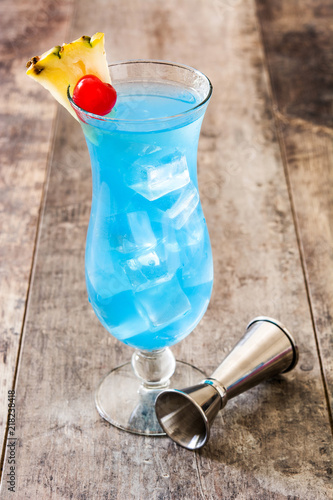 Blue Hawaiian cocktail on wooden table