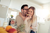 Young happy couple sitting in modern apartment and having breakfast together. - 218260092