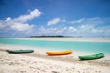 Kayaks on a beach by a tropical lagoon - 218261490