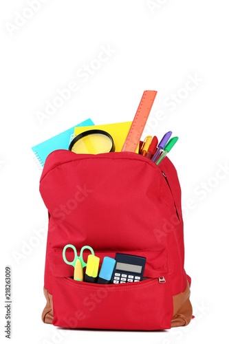 Red backpack with school supplies on white background - 218263009
