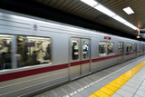 Interior of a Tokyo subway station and platform with subway commuters in Tokyo, Japan. - 218297407