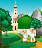 Happy muslim in front of mosque