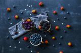 Berries mix  - blueberries, blackberries, cherries and strawberries -in baskets, top view flat lay - 218333866