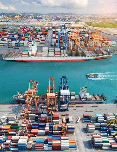 Fototapeta the international port services for the vessels ships working in loading discharging units container cargo shipment, export and import under structure of logistics and transport system to Worlwide