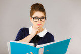 woman thinking holds file folder with documents - 218368243