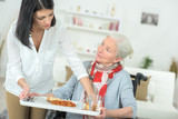 taking the tray from the elderly - 218417600