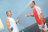 Men on badminton court - 218418851