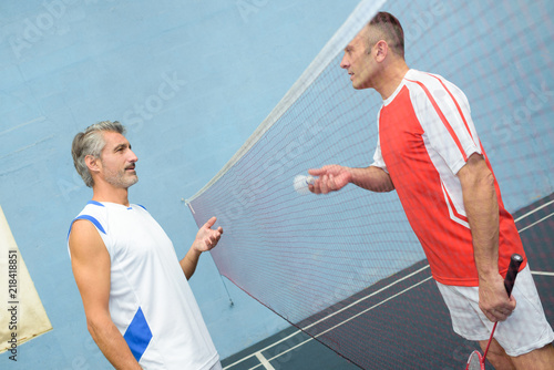 Fototapeta Men on badminton court