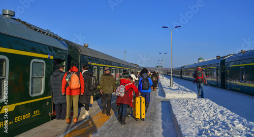 Fototapeta Passengers at railway station