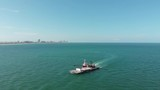 Barge being pushed off the coast of Miami Beach. - 218452263