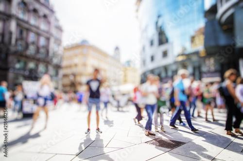 Plexiglas London Crowd of anonymous people walking on busy city street