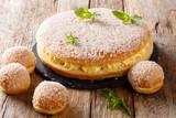 Delicate tropezienne tarte - brioche sandwich cake with cream close-up. Horizontal - 218474046