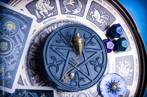 horoscope with zodiac signs, astrology dice, pendulum, pentagram and cars like esoteric concept  © starblue