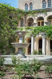 An ancient building with an arcade and a fountain. Tauric Chersonesos. Crimea. Sevastopol - 218484440
