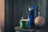 Hot black coffee and vintage blue pot