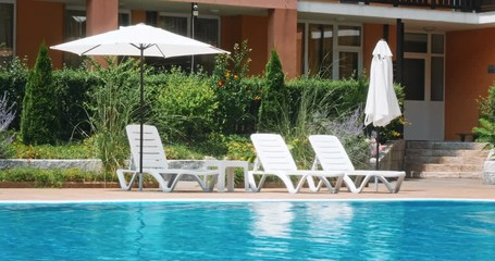 Beautiful luxury umbrella and chair around outdoor swimming pool © uhdenis