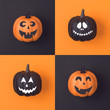 Halloween holiday concept with jack o lantern pumpkin decor with funny faces