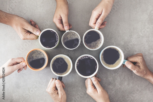 People hands holding cups of coffee - 218524824