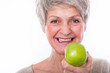 beautiful mature healthy woman with apple