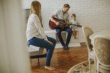 Happy family with guitar - 218568051