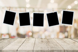 Empty wood table and instant photo hanging on blur image background of people display montage for product. - 218574429