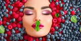 Beauty fashion model girl lying in fresh ripe berries. Face in colorful berries closeup. Beautiful makeup, juicy and sexy lips, pink eyeshadows - 218591486