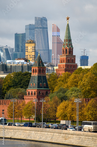 Walls and towers of the Kremlin against the business center Moscow City. Vertical.