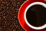 Red coffee cup with coffee beans .