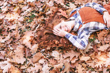 young happy redhair beauty in leaves - 218623017