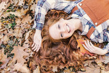 young beauty red hair in leaf  - 218624814