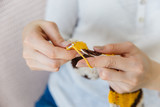 a woman knitting warm socks at home - 218644277