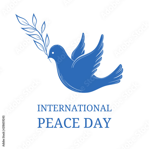 International Day of peace. Dove of peace with olive branch on blue ...