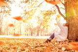 sunny october girl with red hair  - 218659664