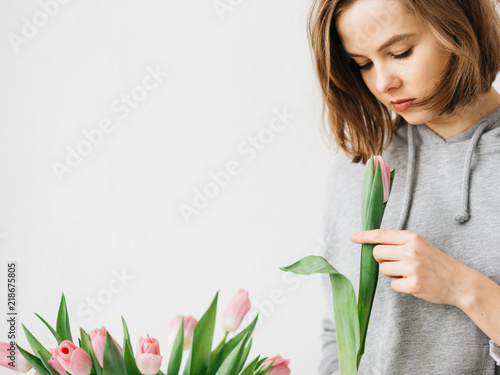 Young woman with tulip flowers bouquet