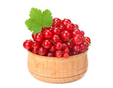 red currant in wooden bowl with green leaf isolated on white background. healthy food