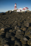 Lighthouse Surrounded by Rocks Covered in Seaweed During Low Tide - 218687808