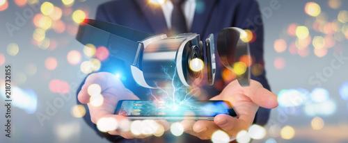 Leinwanddruck Bild Businessman using virtual reality glasses technology 3D rendering