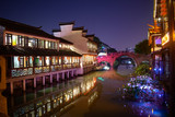 Old chinese water village buildings at night