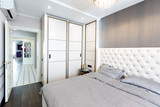 Modern bedroom interior with a big bed and a Chandelier - 218787035