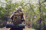 Trekking with backpack in the forest