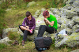 Couple of hikers resting - 218792863