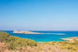 Beautiful beach of Crete with turquoise water. A popular tourist beach. Kolokitha beach. Peninsula Kalydon. Crete, Elounda,Greece. - 218864063